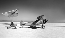 Vintage Motorized Hang Glider And Small Propeller Plane On The Surface Of The Salt Lake. Mixed Media