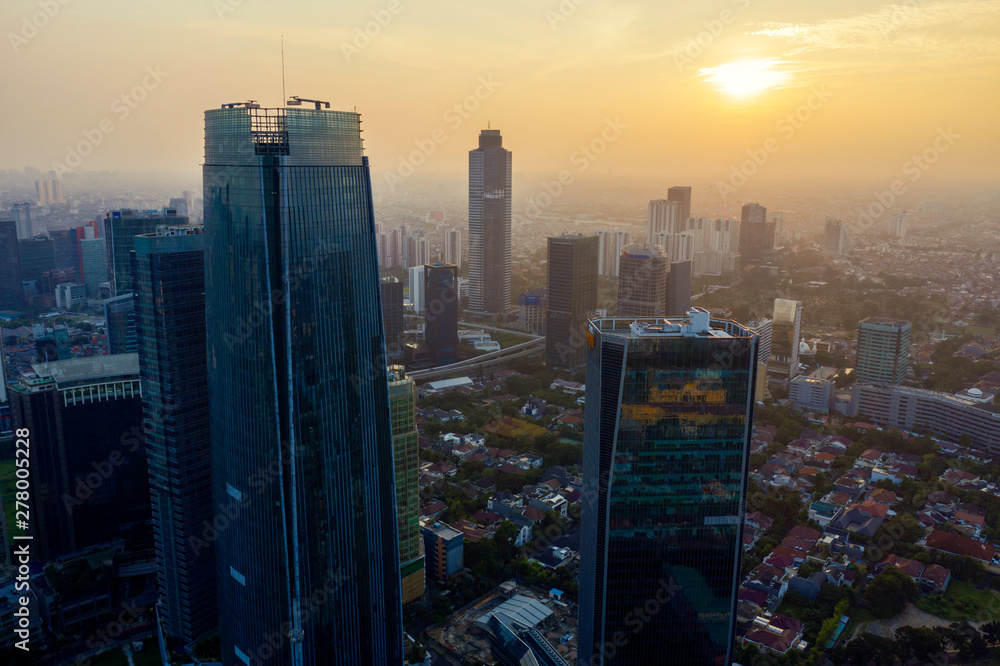 Fototapety, obrazy: Dense residential with skyscrapers at sunset