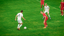 Professional Soccer Players Playing Pass Trying To Score A Goal. Impressive Professional Match On International Championship.