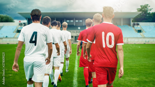 Two Professional Soccer Teams Leaving The Field After Successful Match Fototapete