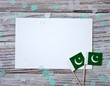 independence day of Pakistan. August 14. the concept of freedom, independence and patriotism. flags and confetti with sheets of white paper on a wooden background. horizontal