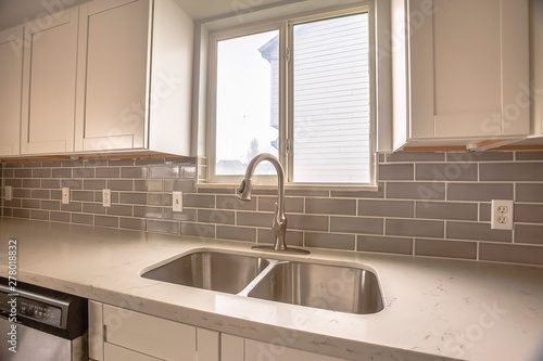 Pinturas sobre lienzo  Double bowl stainless steel sink against tiled wall with window and cabinets