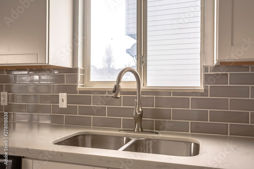 Polished kitchen countertop with double basin stainless steel sink and faucet Canvas Print
