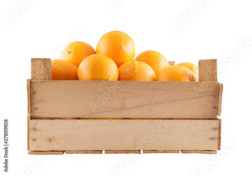 Many ripe orange fruits in wooden box isolated on white - 278019838