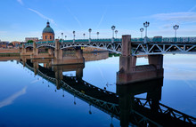 River Side View Of St-Pierre Bridge Crossing The Garonne Early Morning With Clear Reflection In River