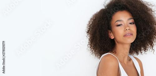 Fototapeta Natural afro -amercian beauty in basic white clothes.  obraz na płótnie