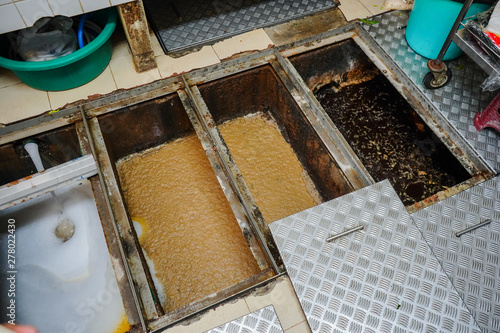 Fototapeta Grease trap, waste disposal,Waste water treatment ponds, waste water disposal procedures obraz