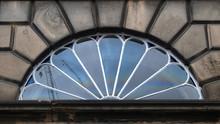 A Semi Circle Window Above A D...