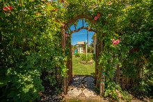 Arched Wooden Arbor At The Ent...