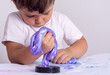 Leinwanddruck Bild - Putty slime with golden sparkle. Kid play with slime.