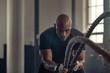 Leinwanddruck Bild - Athletic man using battle rope at gym