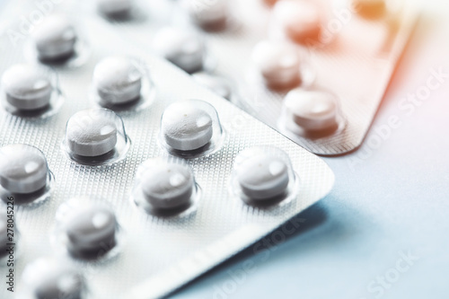 Fotografia  Pills and capsules, social issue, medicine and the pharmaceutical industry