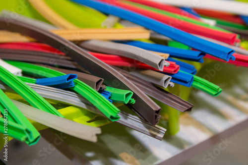 Fotografía  Variety of colored extruded rubber profile (seal). Industry