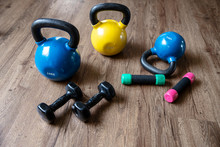 Exercise Weights - Dumbbells  With  Kettlebells On A Floor In Ygm