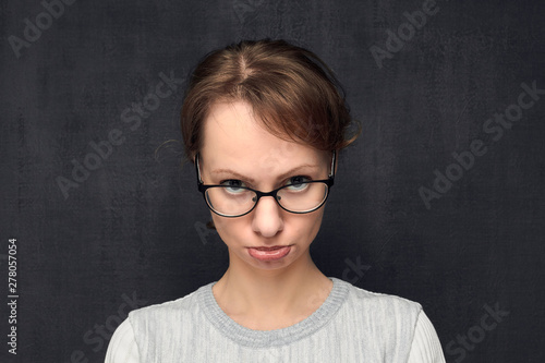Fotografia, Obraz  Portrait of discontented and funny girl pouting lips
