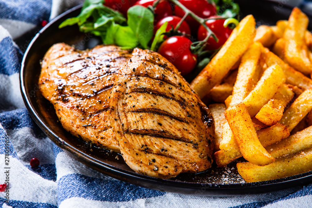 Fototapety, obrazy: Grilled chicken fillet with french fries on wooden table