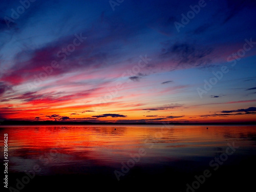 Wall Murals Magenta red sunset sky over the lake, dramatic lighting