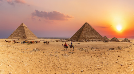 Sunset panorama of the Great Pyramids of Giza, Egypt