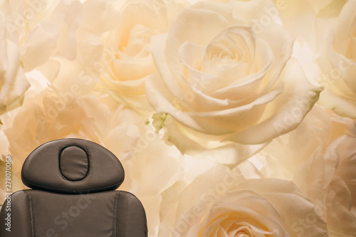 Spa Chair with White Rose Background
