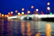 Out of focus night cityscape of Tuchkov bridge and Neva river.