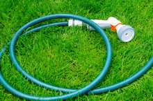 Green Hose For Watering Lies O...