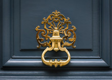 Door Knocker Made Of Brass On A Front Door