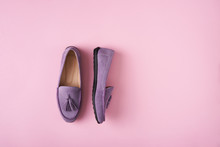 Lilac Suede Moccasins Shoes Over Lilac Pink Background
