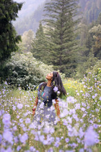 Standing Woman Near Flowers During Daytime