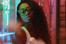 Portrait Of Woman With Glasses Beside Neon Lights