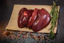 Top View On Group Of Raw Pork Kidneys Served On Craft Paper