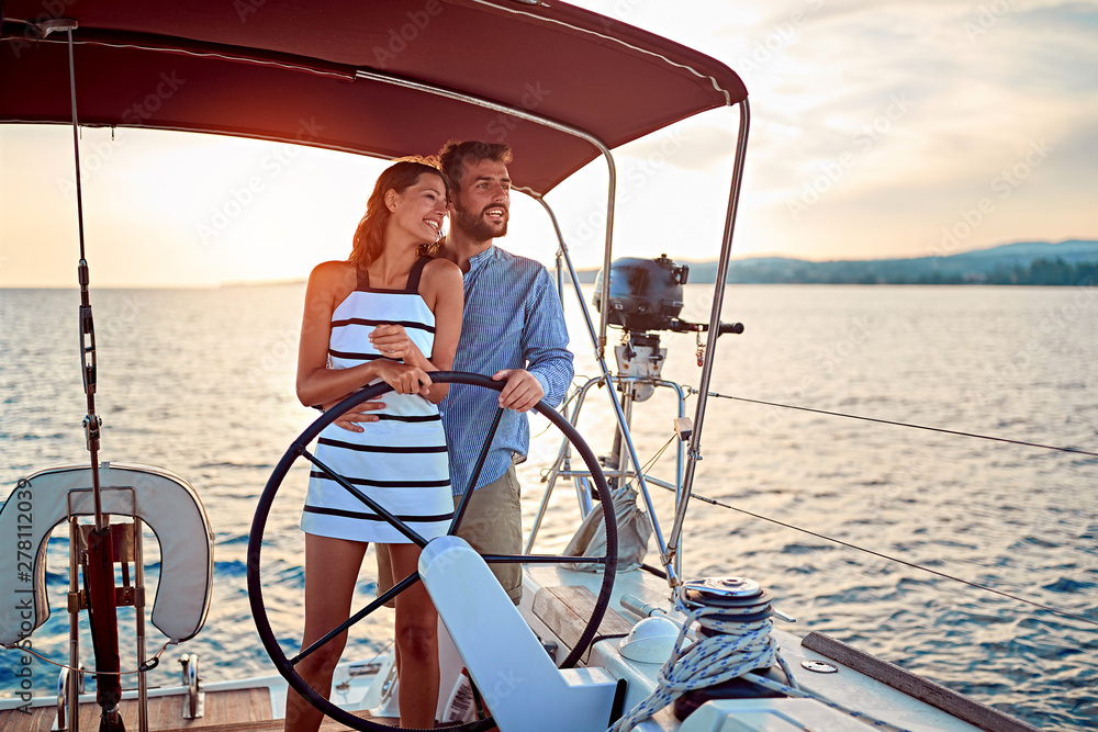 Fototapety, obrazy: couple enjoying on luxury boat at sunset on vacation.