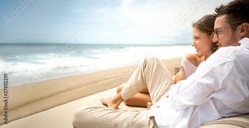 Attractive young couple enjoying in luxury vacation Fototapeta