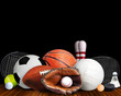 Sports Equipment, Rackets and Balls Isolated on Black Background