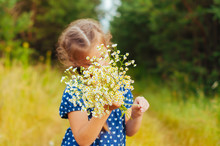Little Cute Girl Gathers A Bou...