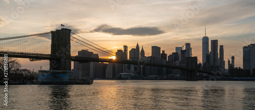 Obraz Banner and cover scene of New york Cityscape with Brooklyn Bridge over the east river at the sunset time, USA downtown skyline, Architecture and transportation concept - fototapety do salonu