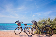 Two Bicycles Isolated On Paradisiacal Beach In Mallorca
