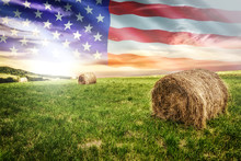 National Agricultural Industry Concept - Idyllic Farm Field With Hay Bales On On The Background Of The USA Flag (mixed).