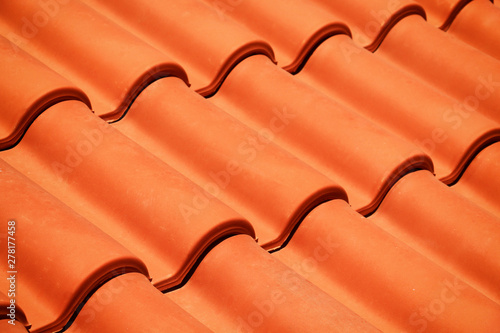 Fototapeta new red roof tiles closeup obraz