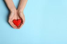Woman Holding Heart On Blue Ba...