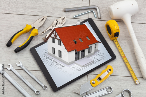 Poster Fleur Tablet with construction tools and 3d home plan concept