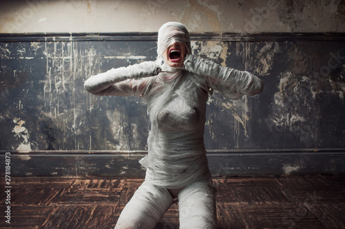 Canvas mummy screams in horror and tears the bandages