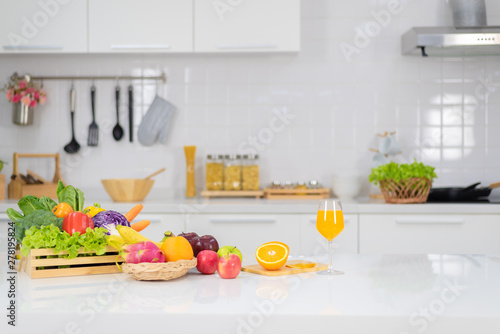 Foto auf Leinwand Saft Orange juice is placed on a white table, orange juice, bright colors placed on the table and the atmosphere in the kitchen is clean white.