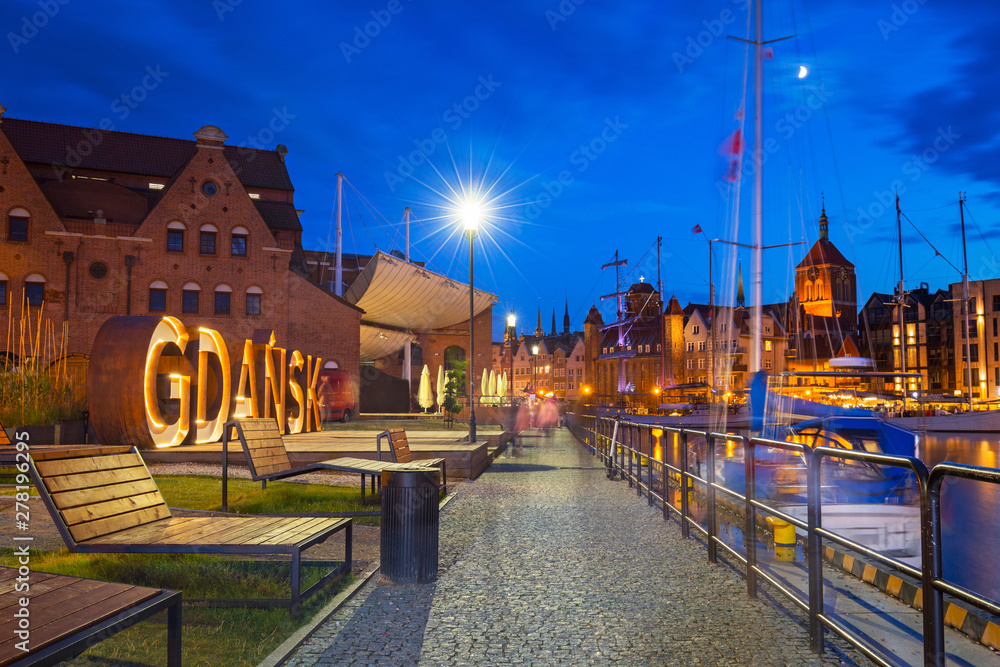 Fototapety, obrazy: Beautiful architecture of Gdansk with an outdoor sign at dusk, Poland