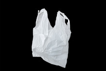 White Plastic Bag Isolated On Black,it Is One White Plastic Bag Isolated On Black.