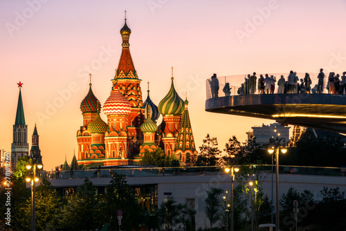 Foto auf Leinwand Rosa hell Moscow city center at night, Russia. People in Zaryadye Park overlooking St Basil`s Cathedral and Moscow Kremlin. This place is tourist attraction of Moscow. Concept of travel and vacation in Moscow.