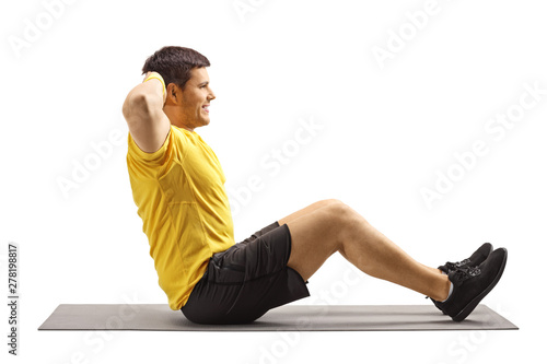 Photo Young man exercising abs on the floor