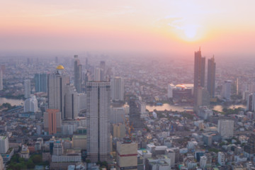 Blurred building/Background of cityscape concept: Blurred aerial view building big city on amazing golden warm light at sunrise /