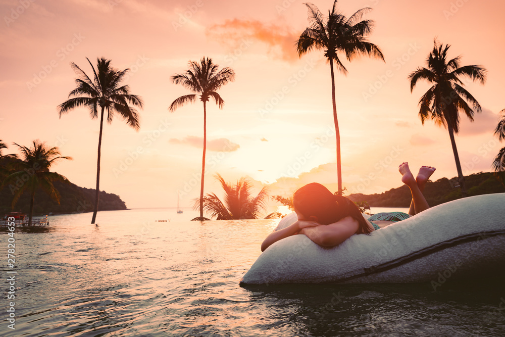 Fototapety, obrazy: Asian woman relax in pool on beach