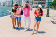 One couple is reading a map while the other is taking photos on their summer vacation.
