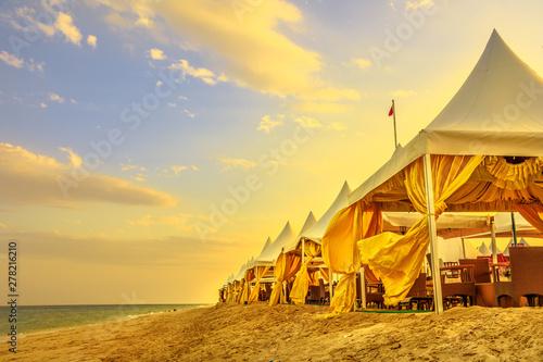 Fényképezés  Luxurious tents at desert beach camp, Inland Sea, Khor al Udaid in Persian Gulf, southern Qatar
